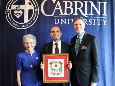 Abel, Sr. Christine, and Mark with MSC Seal