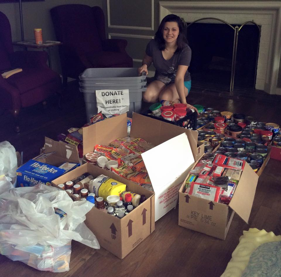 Student with boxes of food donations