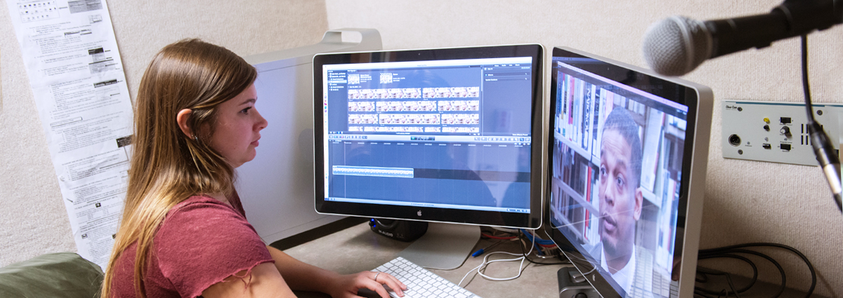 A Cabrini student in an editing booth