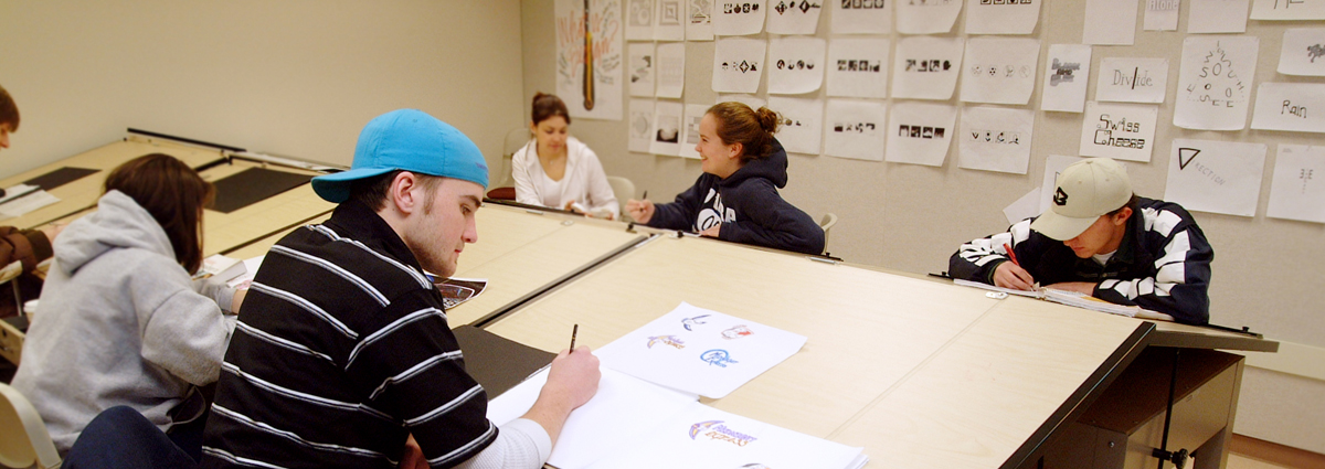 Cabrini graphic design students at drafting tables