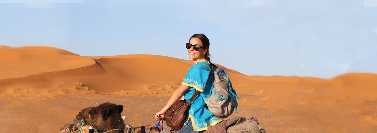 A Cabrini student on a camel during a study abroad trip