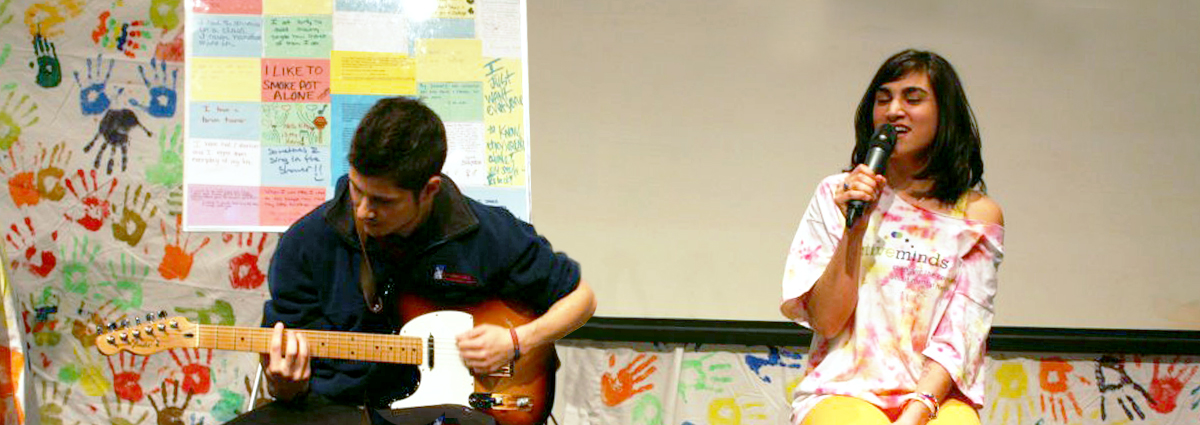Cabrini students playing guitar and singing at an Active Minds event