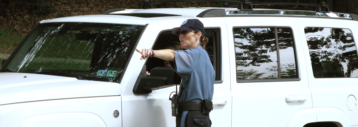 A Cabrini Public Safety Officer, giving a driver directions