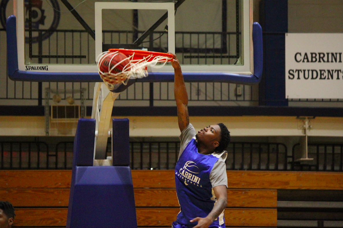 Cabrini student dunking a basketball