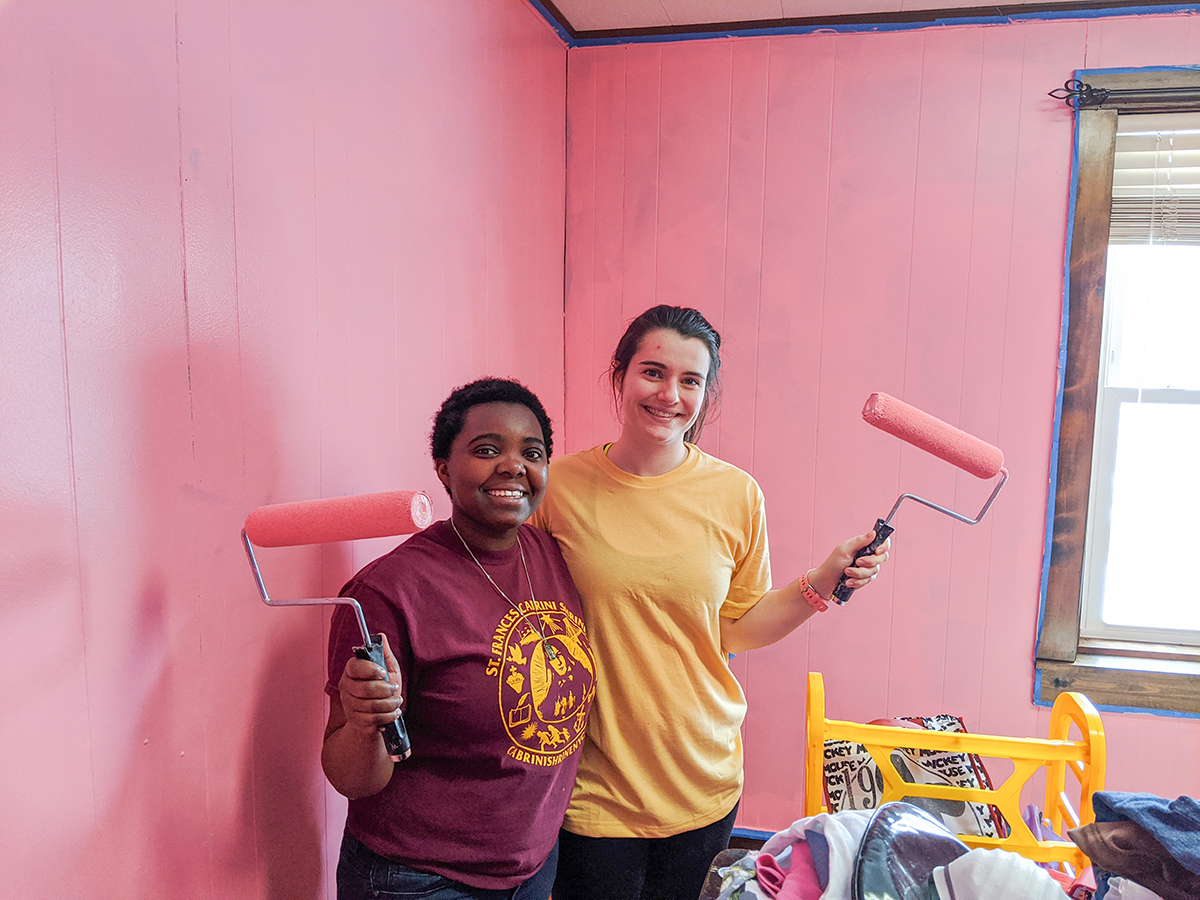 Evelyn and Rachel paint bedroom