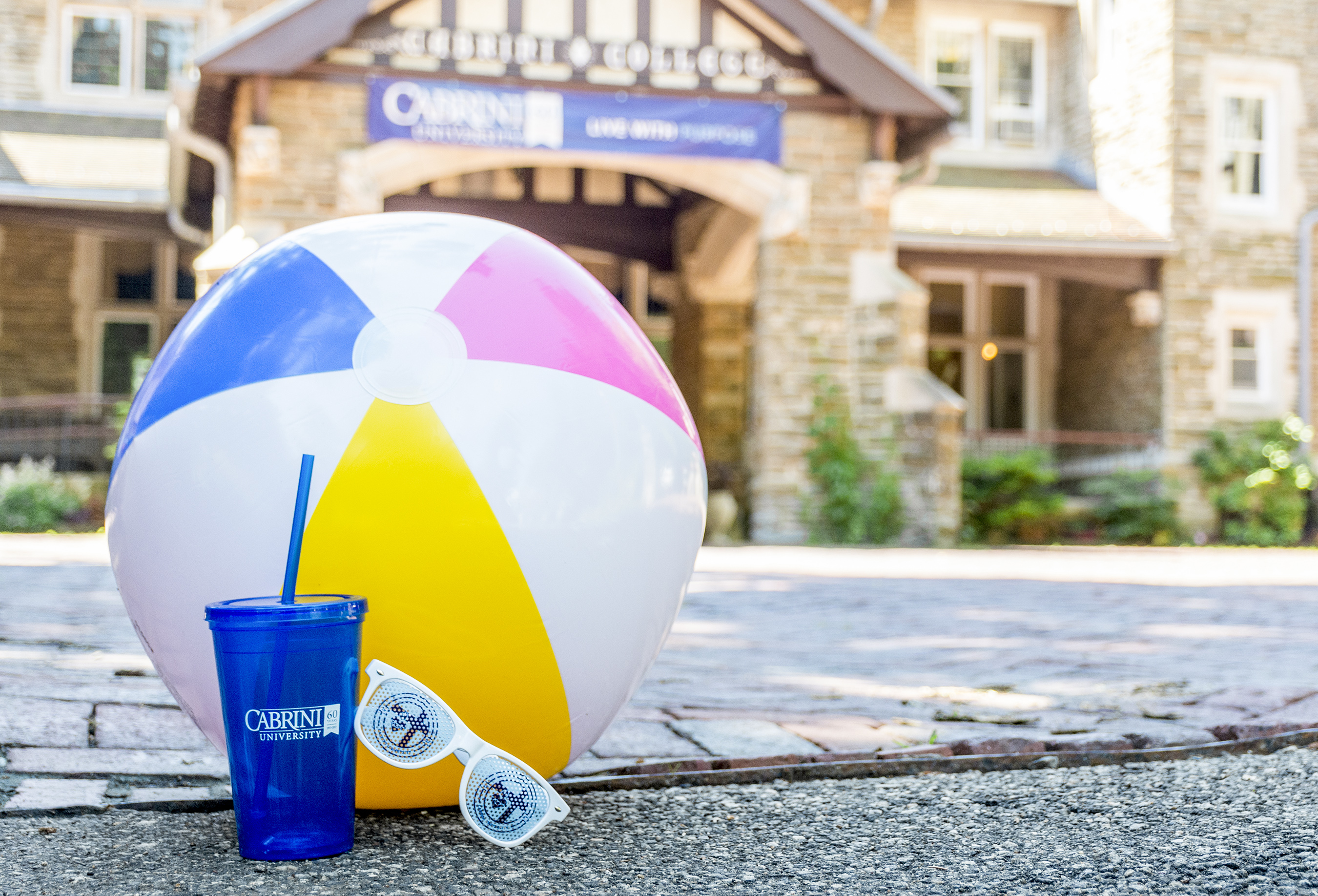Beachball and sunglasses outside the Cabrini mansion