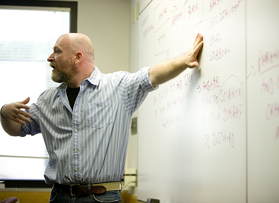 A Cabrini professor at a whiteboard
