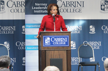 Judge Hughes speaking at Cabrini
